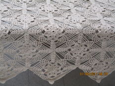 Ecru coloured crochet tablecloth or bed-spreads.