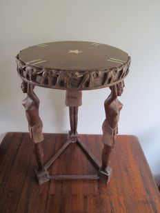 Antique African wooden side table with considerable amount of carving and bone inlays