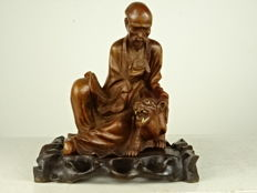 Wooden sculpture of a scholar with a tiger - China - first half/mid 20th century