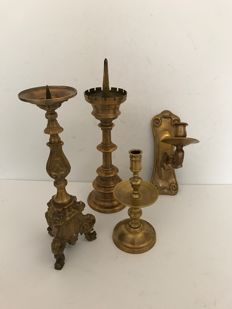 Two brass pen candlesticks a brass wall candle sconce and a collar candlestick - France - first half of 20th century
