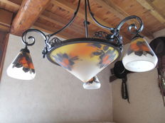 Ceiling suspension with three tulips and a globe signed deveau in great condition, painted with fruit decor wrought iron with grape decor.