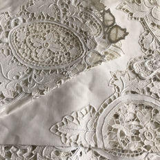 Beautiful old tablecloth embroidered by hand and its towels