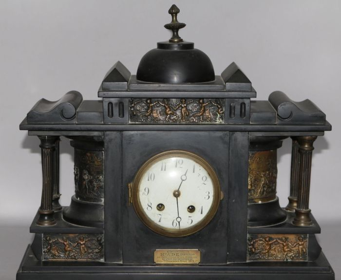 A French black slate ornate clock - circa 1850