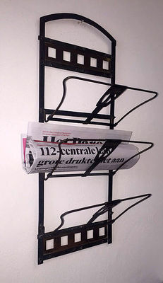 A metal Art Nouveau magazines rack with three folding parts, Netherlands-Germany, early 20th century