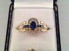 18 karat yellow gold ring with diamonds and sapphires; ring size, 16.75/53