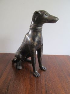 Bronze sculpture of a whippet dog