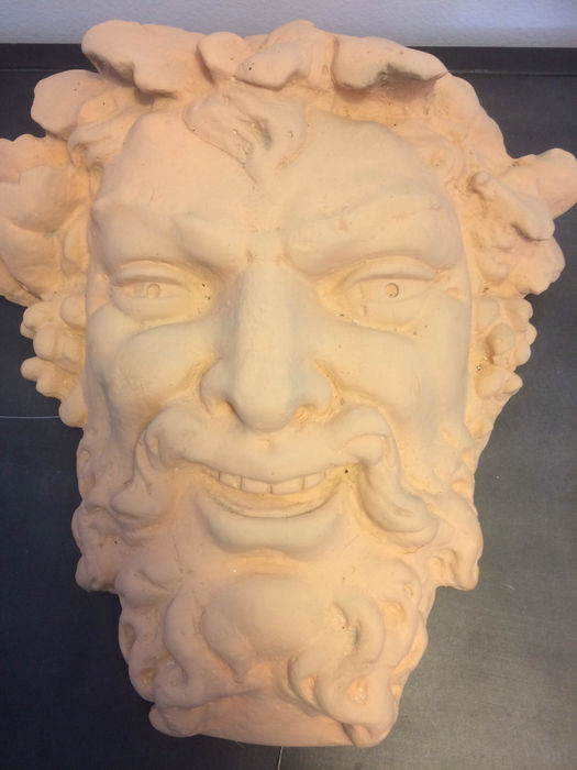 Head of Bacchus in plaster of large dimensions.