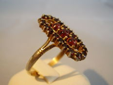 Victorian garnet ring with faceted antique rose cut garnets
