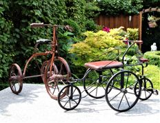 Particular metal children's toys: a tricycle and a quadricycle.