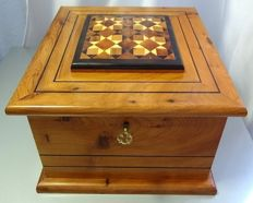 Mahogany box with cover decorated with various hardwoods.