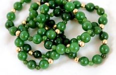Long vintage necklace of 14 K beads and genuine Jade-Nephrite beads in dark spinach or forest green colour, 1950's