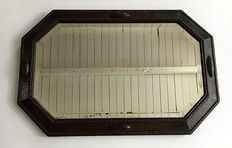 Art Deco style cut mirror with an oak frame, first half of the 20th century