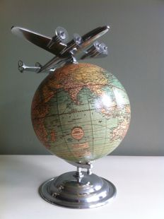 Vintage look globe with aeroplane, globe with plane