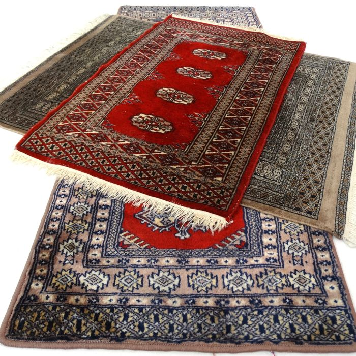 "Trio of Bukhara rugs - ""Three finely knotted Persian carpets in beautiful condition"" - With certificate."