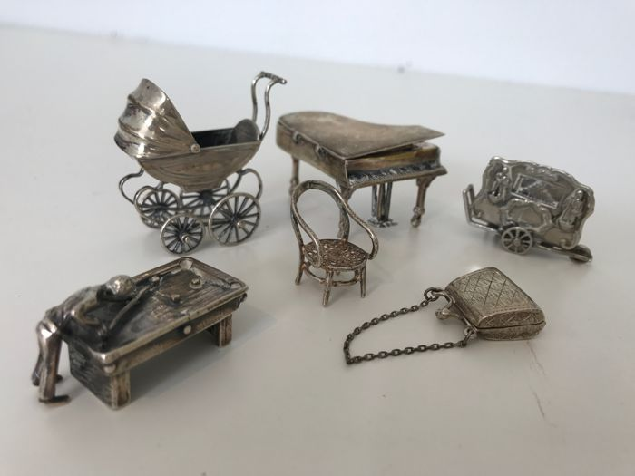 Silver miniatures, six miniatures, stroller, grand piano, organ, pool table, chair and purse which can open