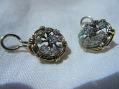 Superb earrings set with antique diamonds.