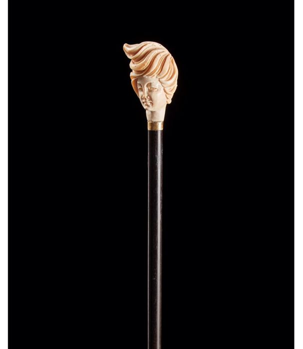 Ebony walking stick with carved coral handle - ca. 1900