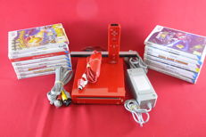 Nintendo Wii Red with 15 games eg Super Mario Galaxy, Mario Party, Just dance and morea