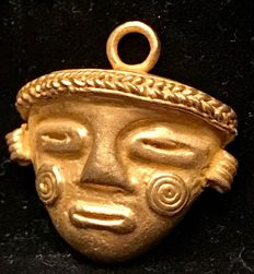 Tumbaga Gold , artifact , Colombian ,  Tairona Culture  , 24 x 23 x 11 mm , 6,5 grams , A pendant of an indian warrior mask