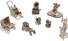 Six silver miniatures and two metal miniatures