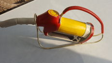 Shell bottle in the shape of the nozzle of a fuel pump - in a holder