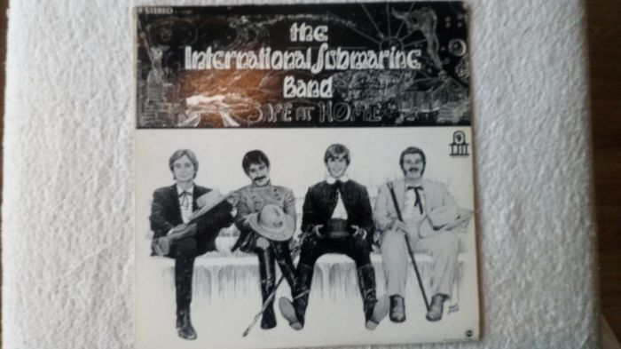 An extremely rare and beautiful album on offer. . The International submarine Band, Safe at Home.