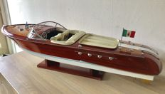 Large handmade wooden scale model of a Riva Aquarama speedboat