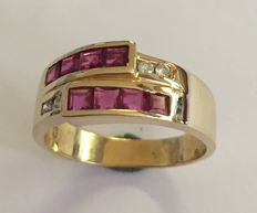 gold ring with rubies* and diamonds (4x) = brilliant cut