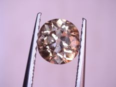0.77 brilliant cut diamond fancy intense yellowish brown HRD certificate