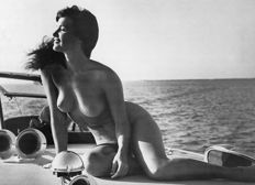 Photo; Bunny Yeager - Bettie Page in Boat - 1980