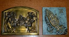 Two bronze plaques, supper and praying hands