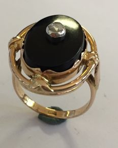 Gold Biedermeyer ring with onyx stone and a rose diamond