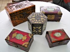 five Chinese boxes including one with jade and bronze ironwork, 1 with mother-of-pearl, one with a beautiful carved wooden box