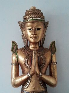 A gold-plated, wooden, kneeling Teppanom figure - Thailand - 2nd half 20th century
