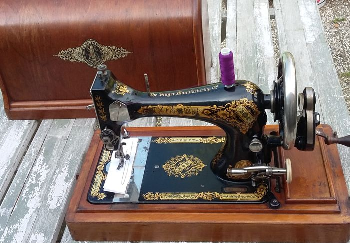 Beautiful decorative Singer 28 hand sewing machine with wooden cover, 1901