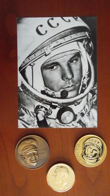 Three plaques and a portrait of Gagarin