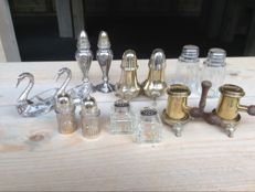 Nice collection of 7 salt and pepper shakers.