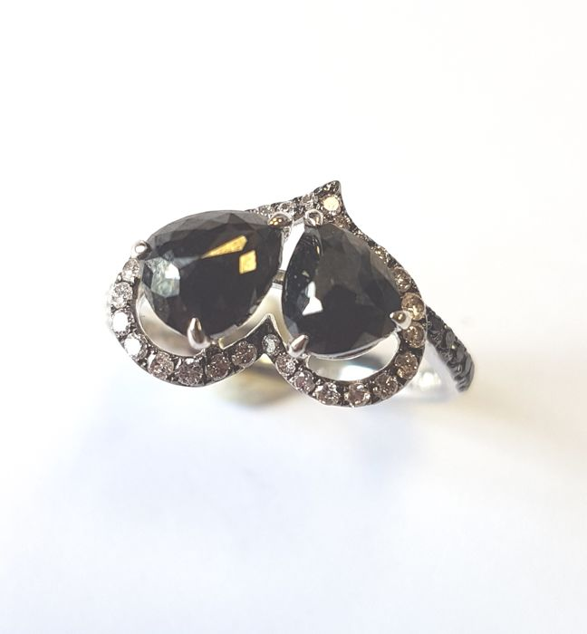Ring in 1.75 carats Black Diamond, 0.33 carats White Diamond in 18 carat White Gold