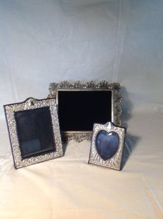 Three photo frames, two in english silver and one in Italian silver, 20th century