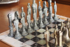Antique chess pieces in lead and bronze, representing Templar Knights and fine marble chess set, in hand-crafted onyx