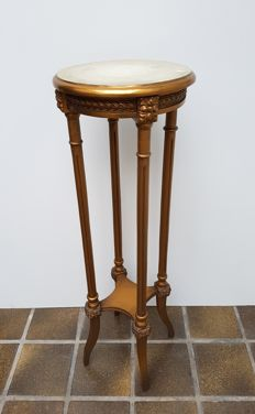 A gold lacquered pedestal in Louis XVI style, circa 1920