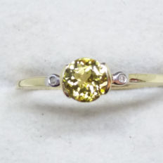 Very rare Genuine 0.81ct Tanzanian Bezel set Yellow Tanzanite with Rio Tinto African Diamonds Solitaire yellow gold ring. (Certificated)