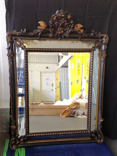 Large Napoleon III overmantel cushion mirror with hand carved ebonised and gilt wood and gesso frame - late 19th century