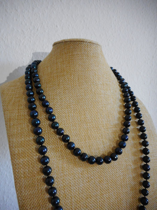 Black  cultured pearl necklace with 14k gold clasp, 50 inch