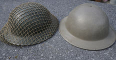 "1 x English Brody ""Tommy"" helmet - 1943 with Camonet and 1 x Belgian post-war variant"