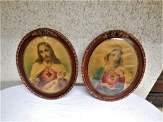 Two old oval saintly portraits with a real wood frame/veneer, gold-plated rose applique and protective glass
