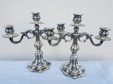 Pair of three-flame candelabra in silver 800, hand hammered with baccellatura of the Vicenza school from the 1950s.