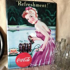a coca cola vintage advertising plate with 5 glass collector's bottles