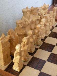 Chess set in wooden box, which is the board. Probably Chinese. LARGE pieces.
