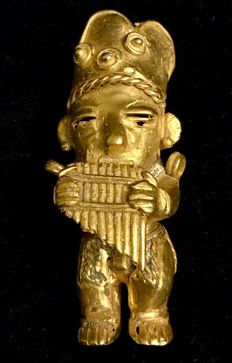 An interesting , Tumbaga gold artefact , Colombia , Tairona Culture, 78 x 36 x 35 mm , 52,34  grams, An Indian native royal musician